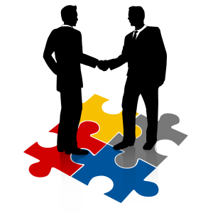 businessmen_puzzle_shake_hands_1600_wht_3191
